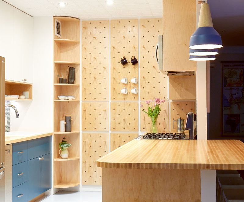 This Small Kitchen Features A Pegboard Wall And Open ...