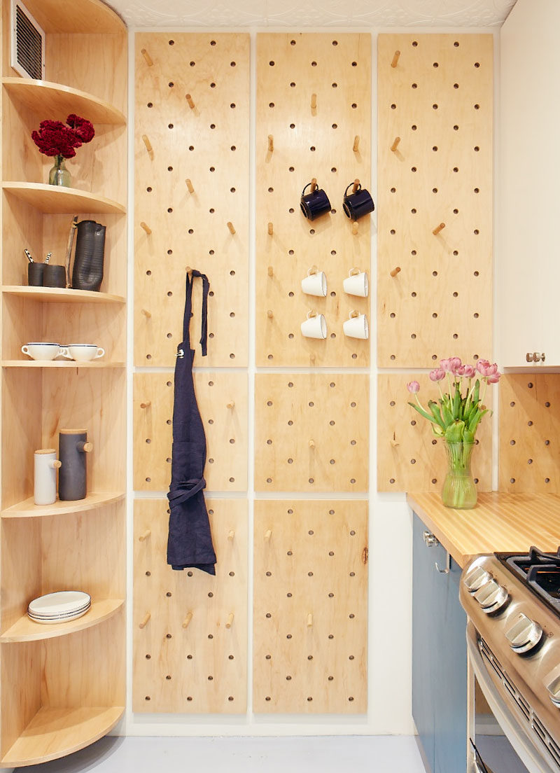 This Small Kitchen Features A Pegboard Wall And Open