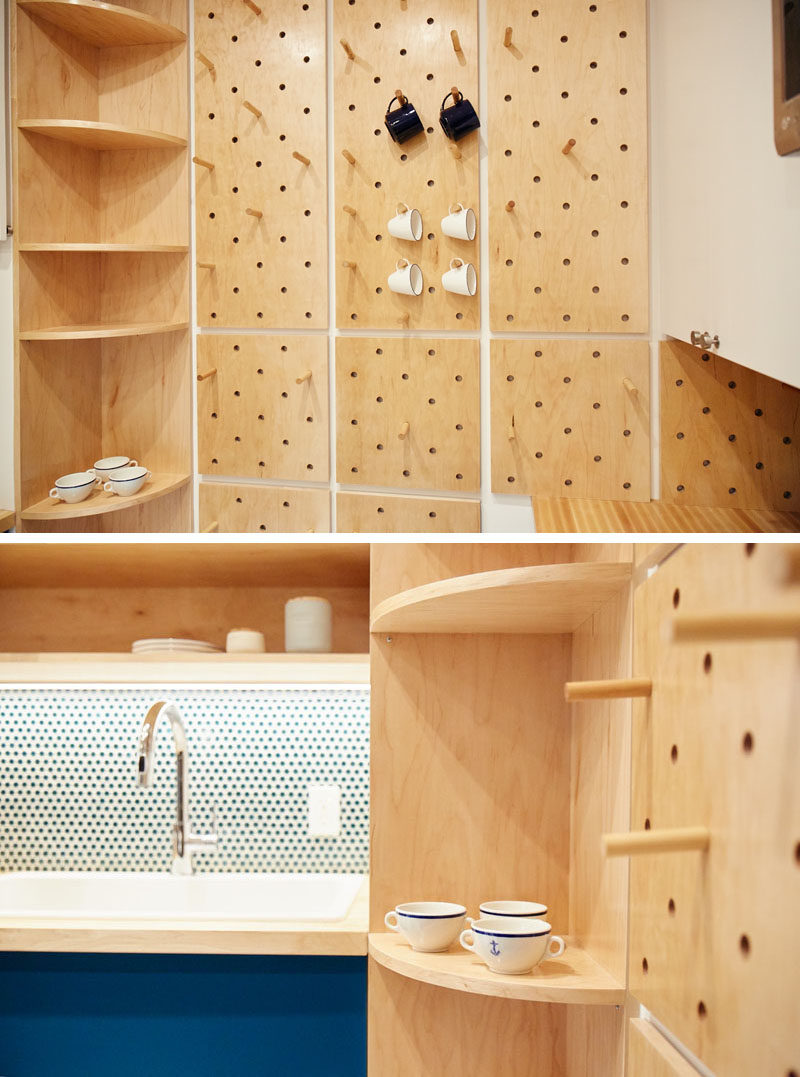 This small and modern kitchen has a custom pegboard wall, a tall curved corner shelf, and open shelves, to increase the storage the kitchen. #KitchenDesign #SmallKitchen #ModernKitchen #Pegboard #CornerShelf