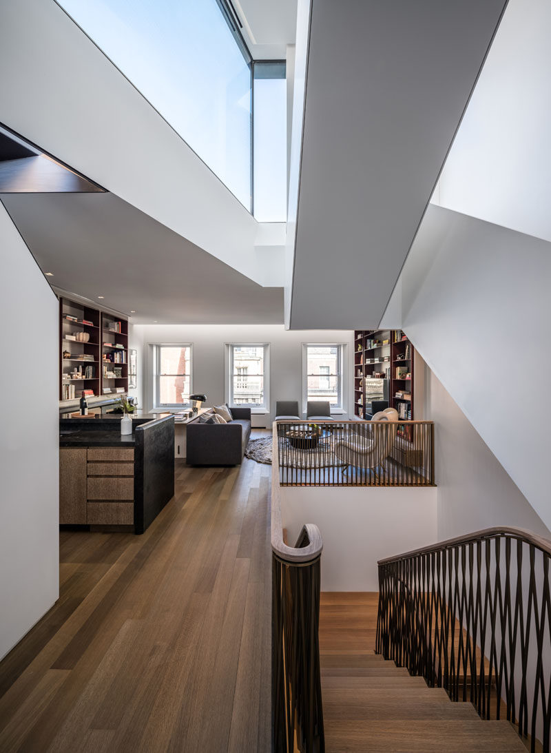 This modern house features a white oak floor throughout, and a home library provides a quiet place to relax. #HomeLibrary #WoodFloors #Windows