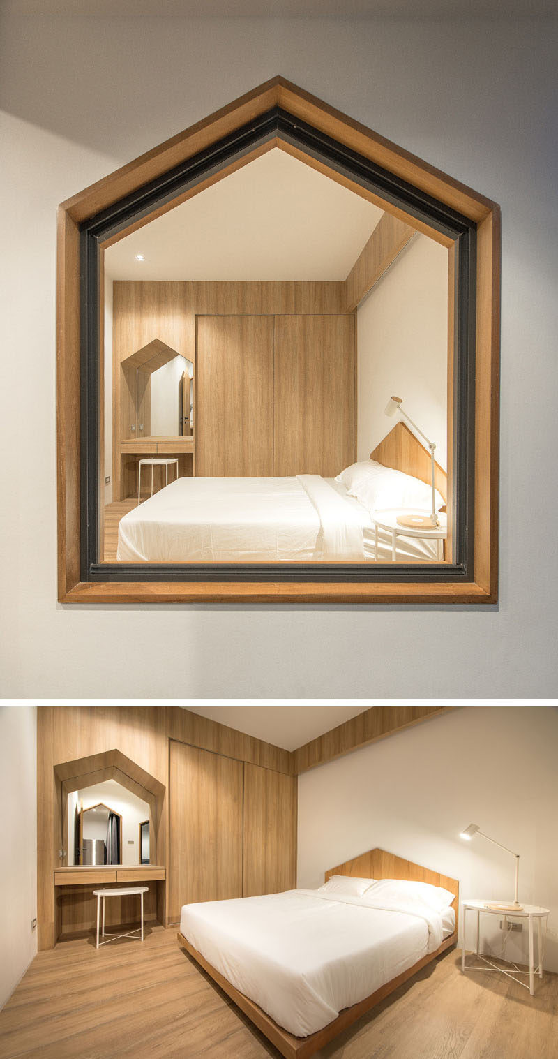 The window frame, build-in desk, and custom bed frame of this modern bedroom all share the same gabled design element. #Gable #Bedroom #Window