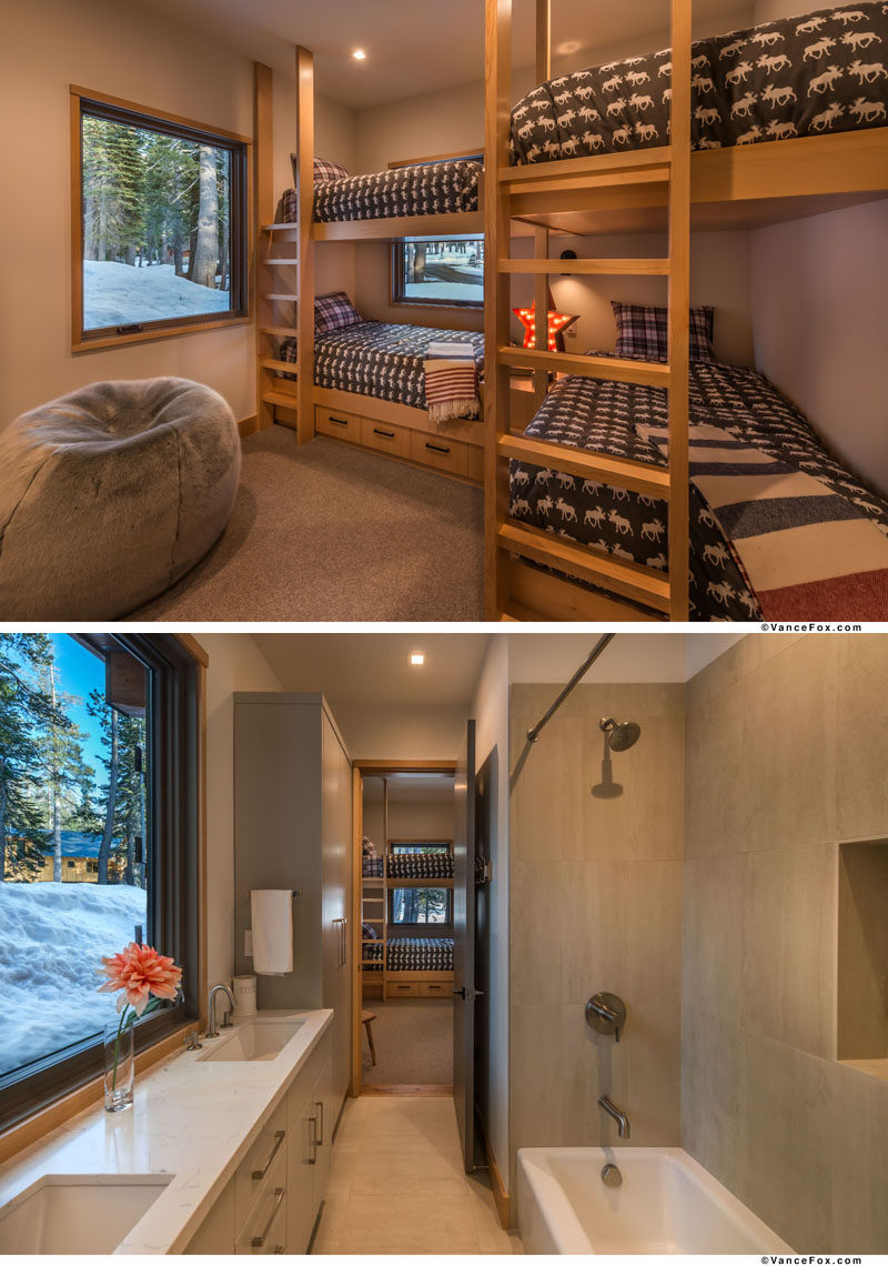 This bedroom has multiple bunk beds, allowing for four people to stay in the one room. Attached to the bedroom is an ensuite bathroom with a bath/shower combo and vanity that sits below the window. #Bedroom #BunkBeds #SleepingForFour #Bathroom
