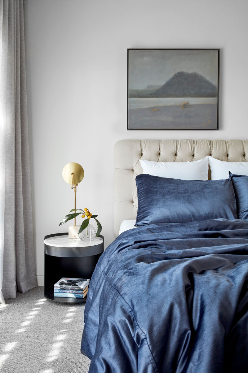 In this contemporary bedroom, simple furnishings create a luxurious and calm atmosphere. #Bedroom #BedroomDesign
