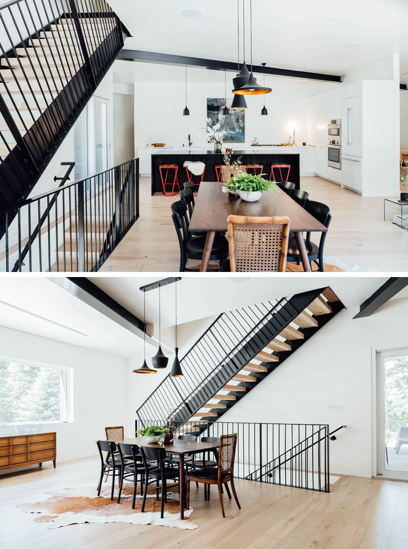 Lightly colored oak floors feature throughout this modern house, while the dining area, anchored in the open floor plan by three pendant lights, is located by the stairs. #ModernDining #DiningRoom #OpenFloorPlan #Stairs