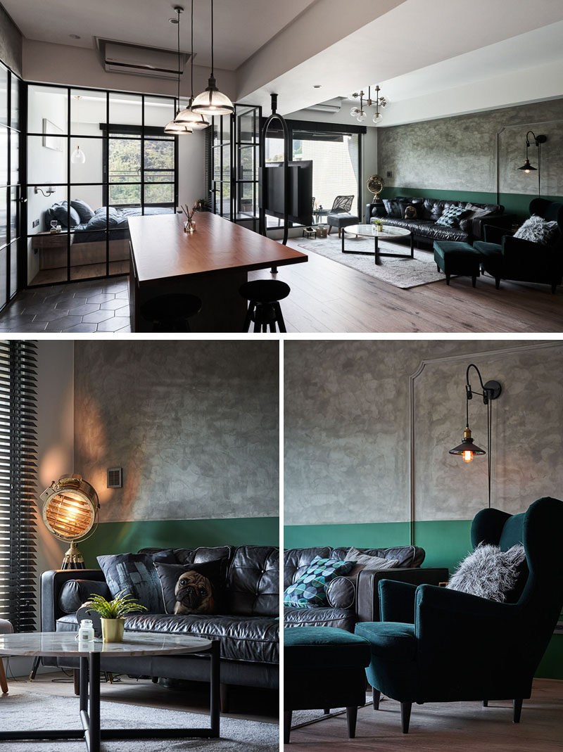 In this living room, a mottled stone wall texture shares the wall with a painted green stripe that covers the lower section of the wall. #LivingRoom #OpenPlanInterior #Apartment
