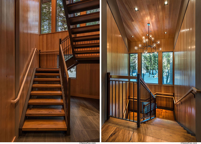 These wood and steel stairs are highlighted by a chandelier. #ModernStairs #StairDesign