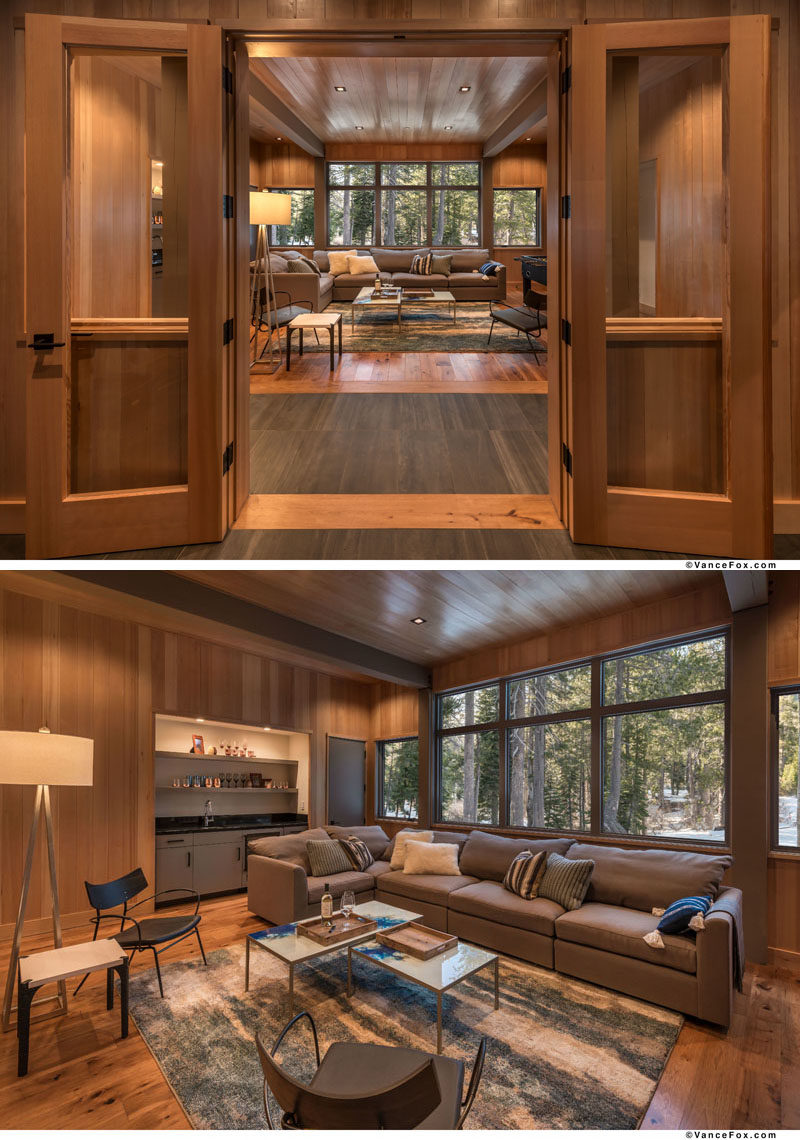 This modern mountain house has a large family room with a wet bar and forest views.  #FamilyRoom #WetBar