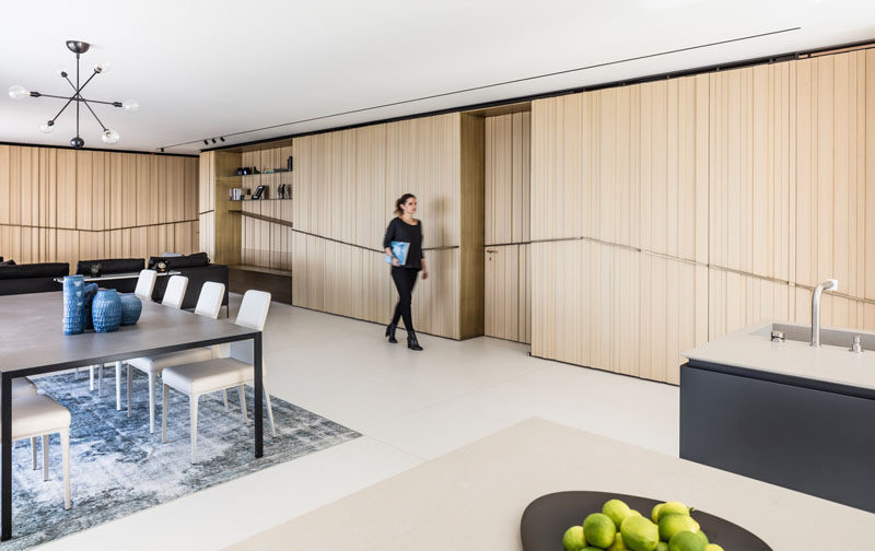 Tal Goldsmith Fish Design Studio have designed the interiors of a modern apartment by the sea inIsrael. #ModernApartment #WoodWalls #InteriorDesign