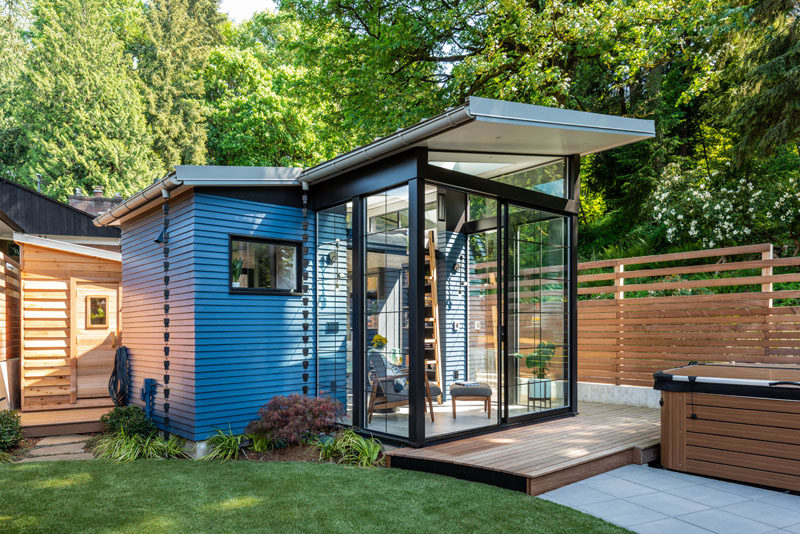 Architecture and design studio Board & Vellum, have createda backyard reading retreat that's surrounded by outdoor seating, a firepit, a hot tub, and anew backyard shed. #BackyardStudio #BackyardRetreat #Architecture