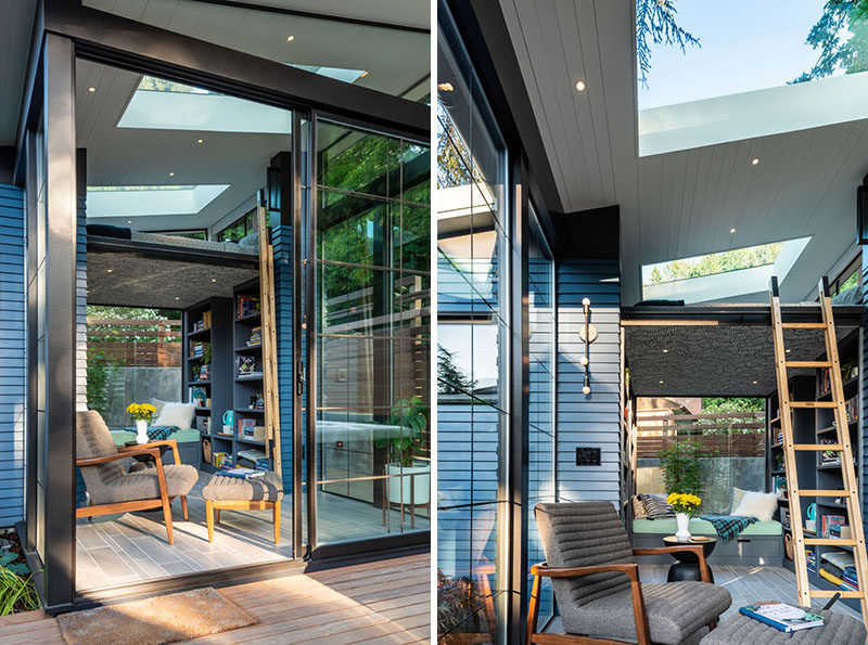This modern backyard reading retreat (backyard studio), has a small patio, a sun-filled sitting area, a loft bed, a built-in bench, plenty of bookshelves, and a bathroom with a shower. #BackyardStudio #BackyardReadingRetreat #LoftBed #Skylight