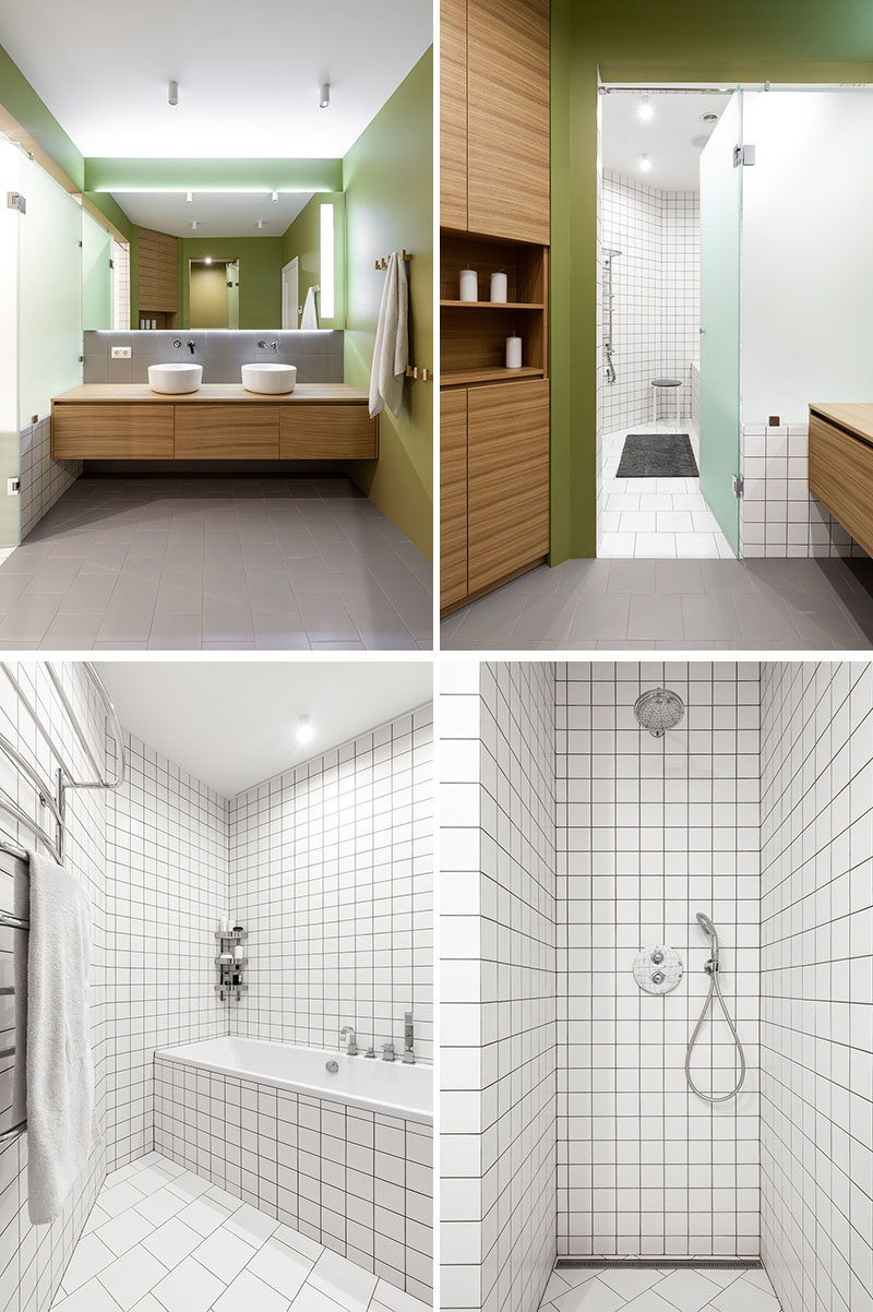 In this contemporary bathroom, olive green paint covers the walls, wood cabinetry provides plenty of storage, and glass frosted doors open to reveal the tiled bath and shower area. #BathroomDesign #ModernBathroom