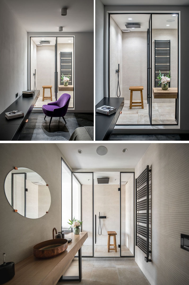 This modern bedroom has a view into the ensuite bathroom. #ModernBathroom #ModernBedroom #BathroomDesign