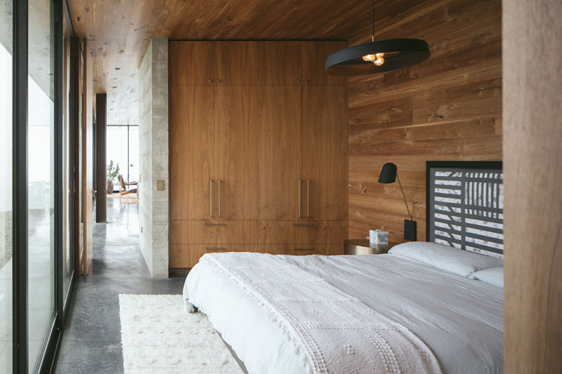 Rich walnut accents and custom fixtures and furnishings by Jessica Helgerson Interior Design add warmth and character to the this modern bedroom. #ModernBedroom #BedroomDesign