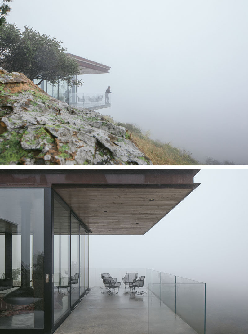 The house has sweeping views of the Pacific Ocean and surrounding rolling hills, that can be seen through sliding glass walls and expansive decks, which cantilever over the foundation's steep rock face. #GuestHouse #Architecture #GlassWalls #Balcony