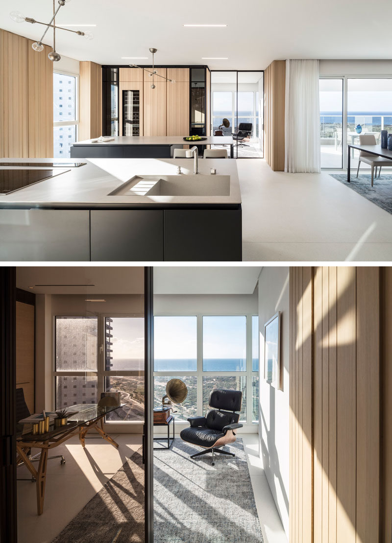 This modern home office of the kitchen, features floor-to-ceiling windows and sweeping views. #HomeOffice #ModernInteriorDesign
