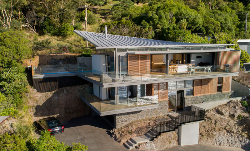 Borrmeister Architects have designed the Scarborough Home, a modern family home that's located on a steep hillside and has views of Sumner in New Zealand. #Architecture #ModernHouse #HouseDesign