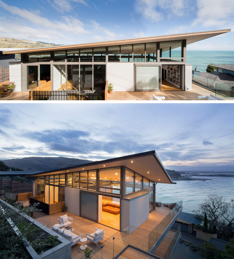 This modern house has a deck that wraps from the front of the house around to the back. #OutdoorSpace #Deck #ModernArchitecture