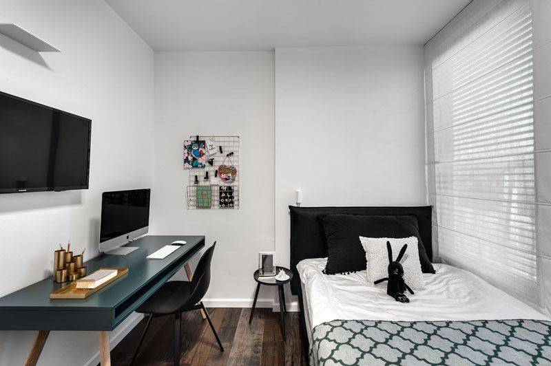 In this modern bedroom, a single bed is positioned by the window, and a desk for study is located on the opposite wall. #ModernBedroom #KidsRoom