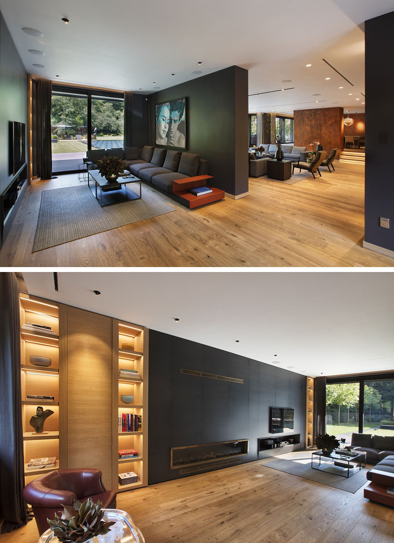 In this modern interior, there's a formal living room, and behind a wall there's a more casual living room with a fireplace and wall-mounted television. #LivingRoom #Shelving #InteriorDesign