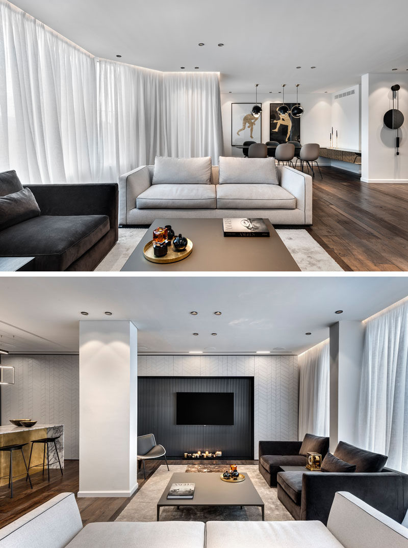 In this modern living room, the furniture is anchored around a large rug, and on the wall, the television is surrounded by a textured accent wall. #ModernLivingRoom #InteriorDesign