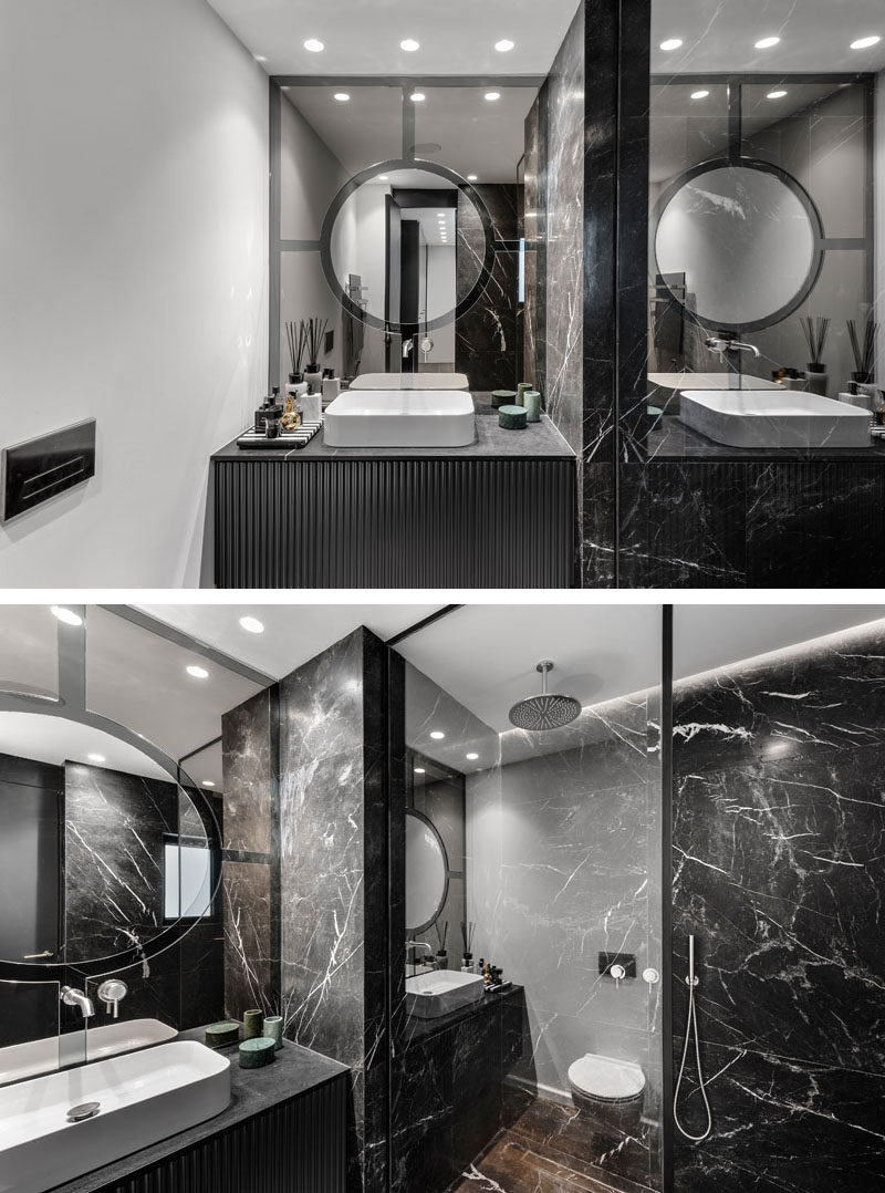 In this master ensuite bathroom, dark elements have been combined with white walls and glass for a luxurious and modern appearance. #ModernBathroom #BlackBathroom