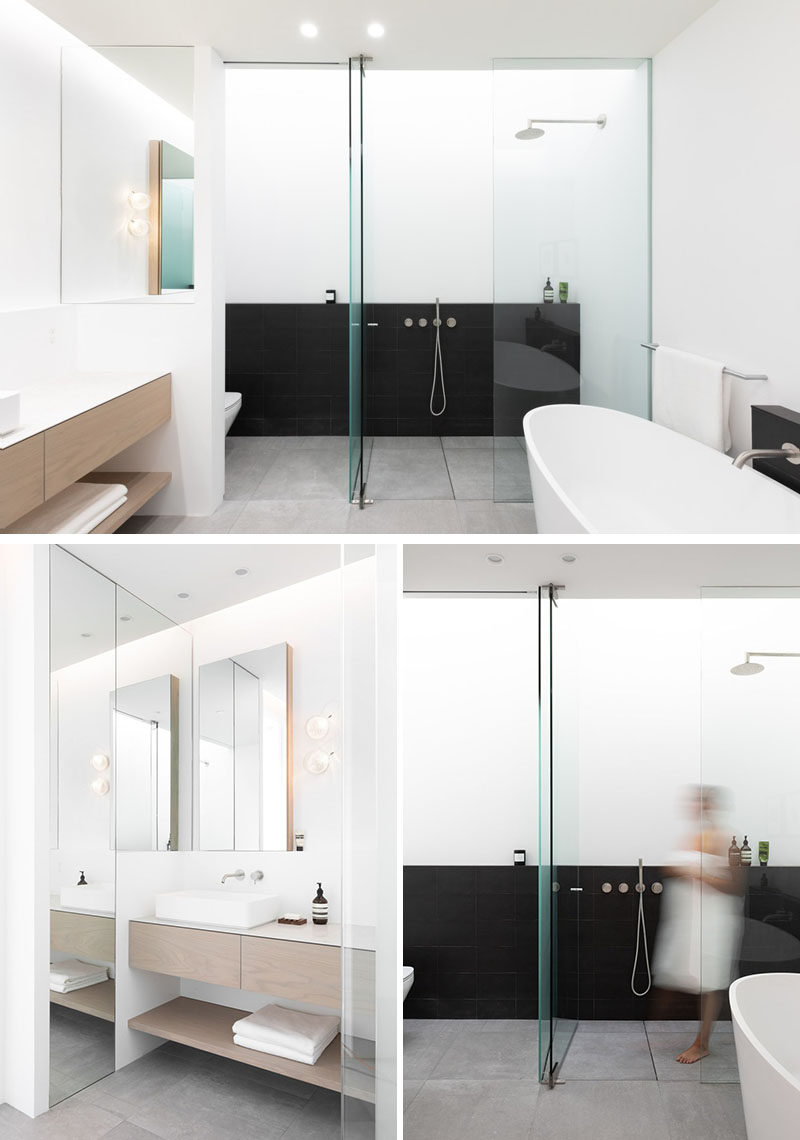In this modern master ensuite bathroom, there's a skylight above the shower that creates a soft diffused light, while black elements contrast the mostly white room. #Bathroom #BathroomDesign #ModernBathroom