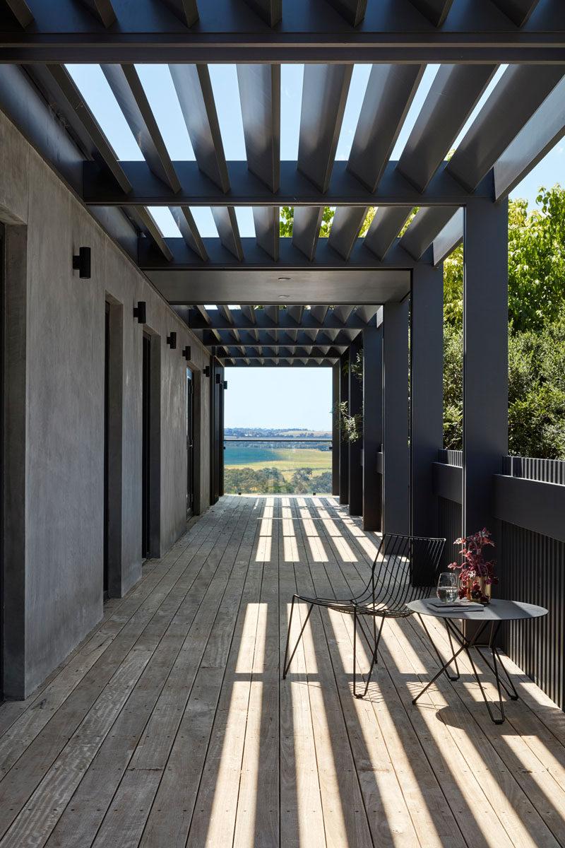 This modern house has a verandah that has views of the countryside. #Verandah