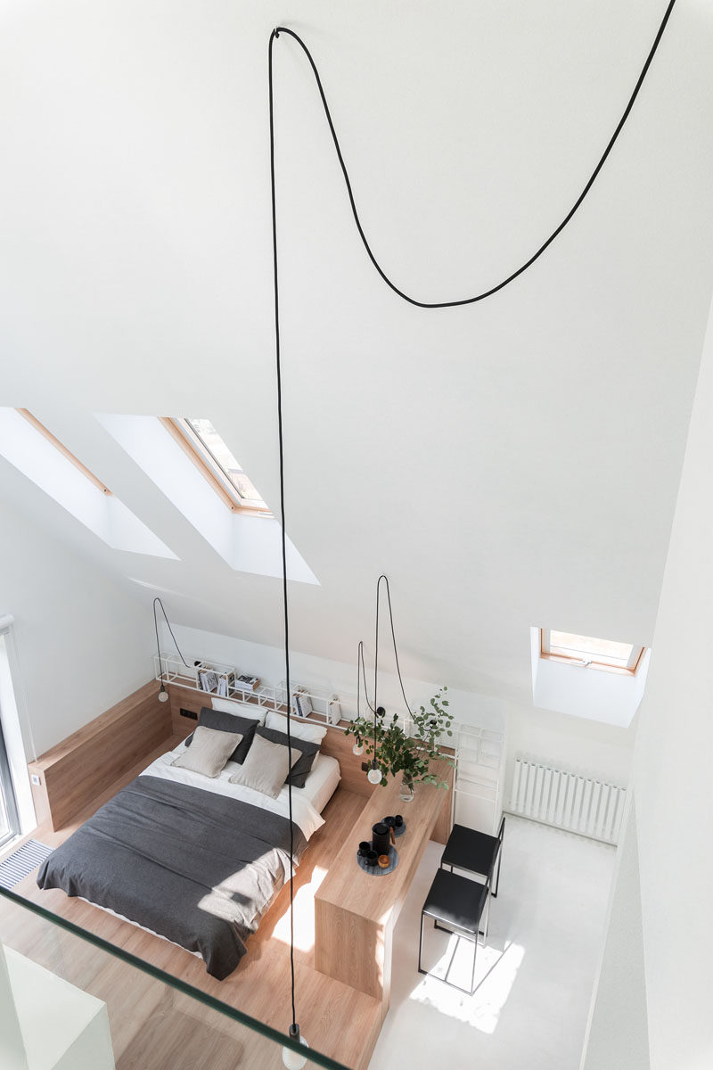 Architecture and interior design firm Ruetemple, have transformed the attic of a house in Moscow, Russia, and made it into a private and relaxing modern bedroom suite with a mezzanine home office. #Bedroom #Attic #HomeOffice #Fireplace #ModernBedroom