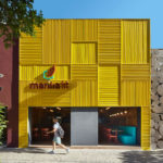 The Facade Of This New Restaurant Is A Bold Grid Of Yellow Aluminum