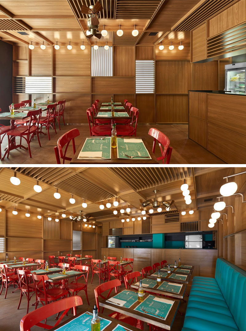 In this modern restaurant, red chairs have been used to add color, and the lighting, designed by the architect, along with Gerbar brass fans, feature on the ceiling. #RestaurantDesign #ModernRestaurant