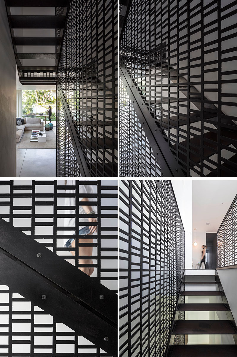 A modern black patterned screen has been used in the stairwell to connect the various floors of the home. #BlackScreen #PatternedScreen #ModernScreen #BlackStairs #StairDesign #ModernStairs