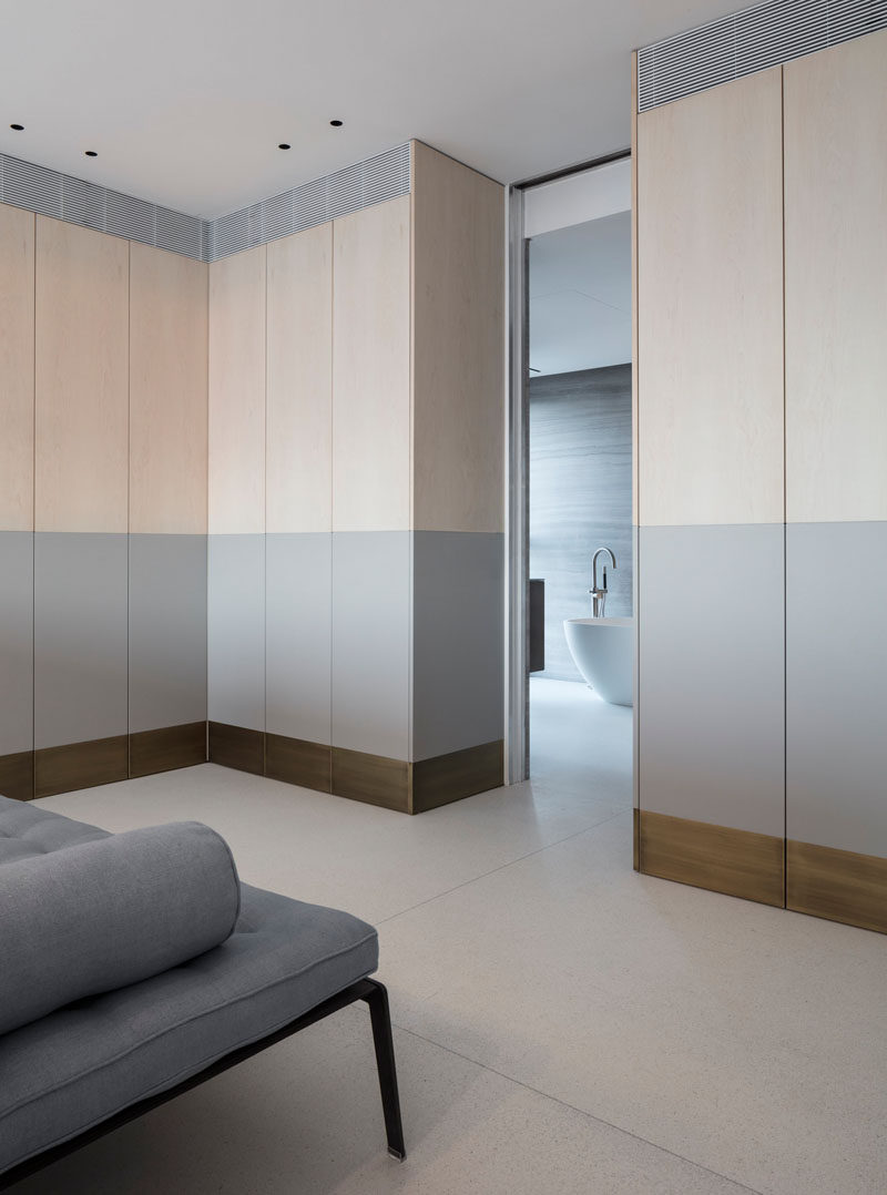 This walk-in closet has two-tone cabinetry in soft colors. #Closet #WalkInCloset #InteriorDesign