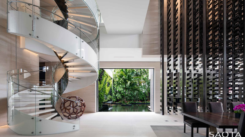This modern house has a white spiral staircase that leads to the private areas of the house upstairs. #SpiralStaircase #ModernSpiralStaircase #Stairs