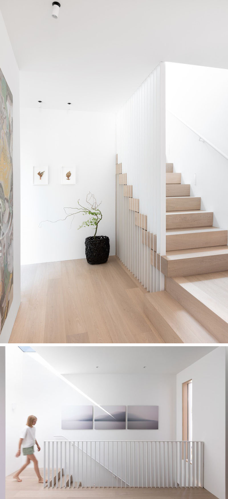 These modern stairs haveslatted steel guards that intersect Nordic Oak treads. At the top of the stairs, there's a skylight that provides natural light to the landing. #ModernStairs #WoodAndWhiteStairs