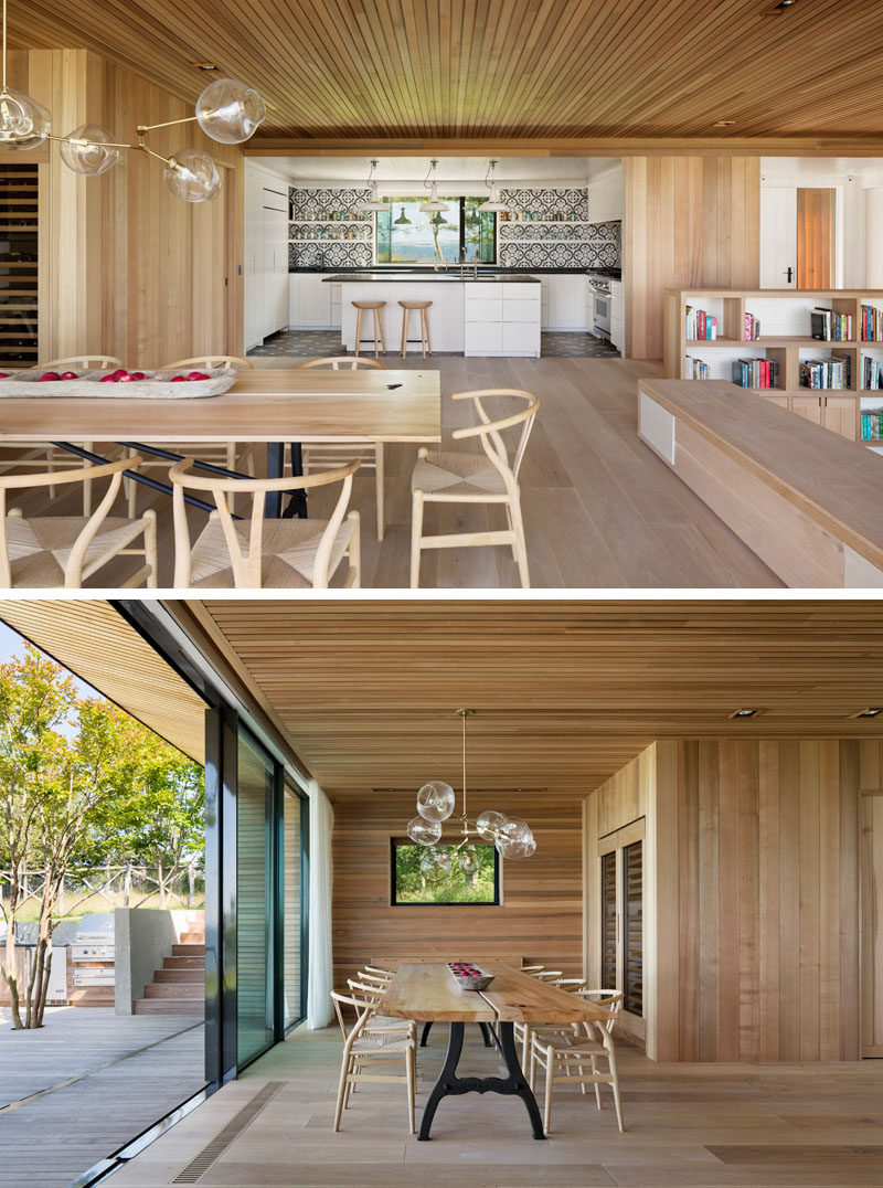 This modern dining room features a built-in wine storage area, and a sliding glass door opens to the terraced deck outside.#DiningRoom #WoodInterior #SlidingGlassDoor