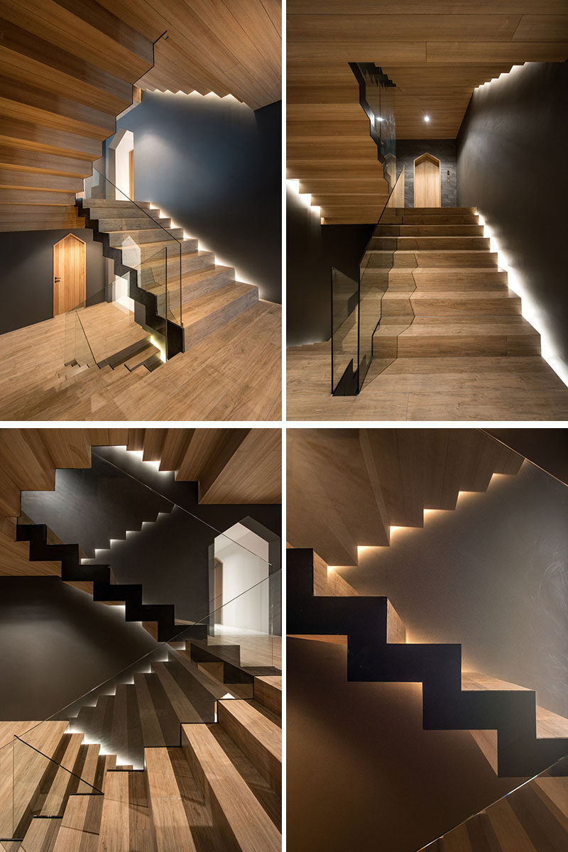 In this modern apartment building, wood stairs have been combined with glass handrails, while hidden lighting showcases the design. #Stairs #ModernStairs #WoodStairs #HiddenLighting