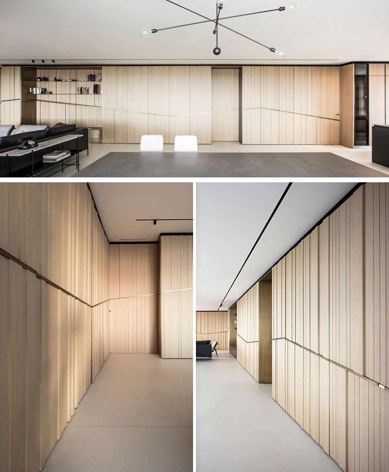 This modern apartment has sea views from every window, and to emphasize and perpetuate the horizon, the designers pulled it's silhouette into the house with a brass element that wraps around the walls. #Walls #WoodWalls #Brass #InteriorDesign