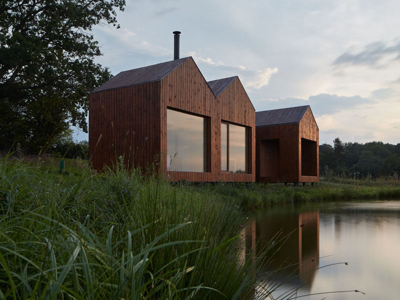 Atelier 111 have designed this small wood cottage that sits on the bank of a pond, and was inspired by traditional fisherman's cabins. #ModernCottage #ModernCabin #WoodCabin #Architecture
