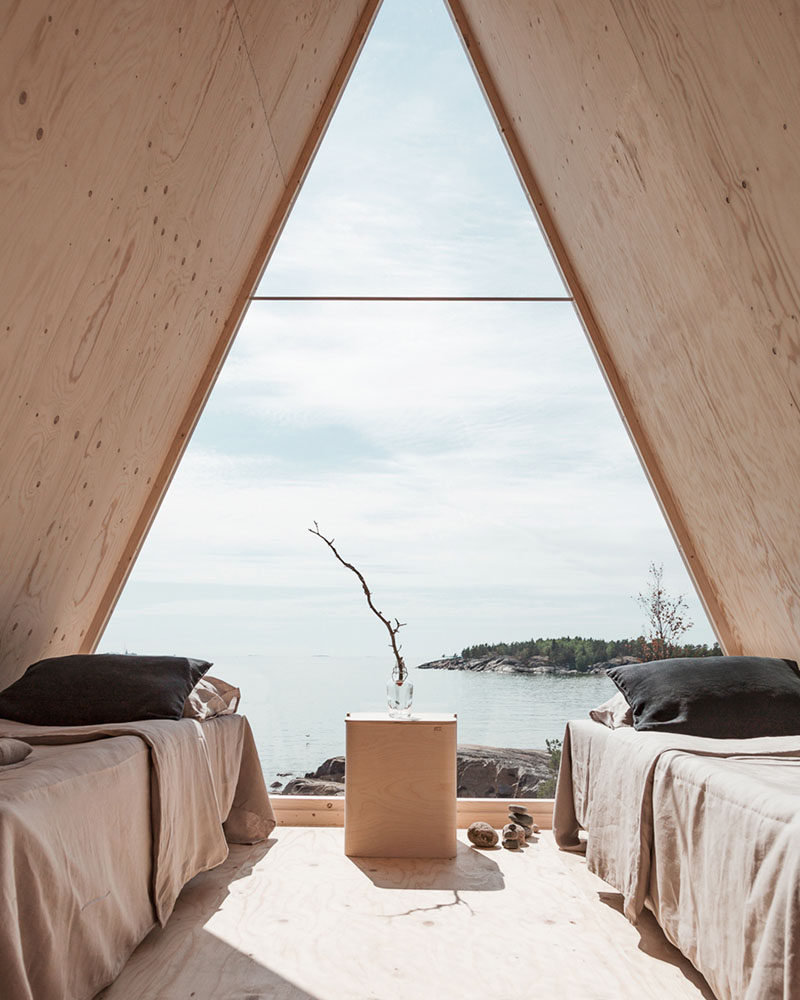 Robin Falck has designed a modern wood and mirrored cabin, that's located in the Finnish archipelago, on the Vallisaari island. #Cabin #ModernCabin #Design #Architecture
