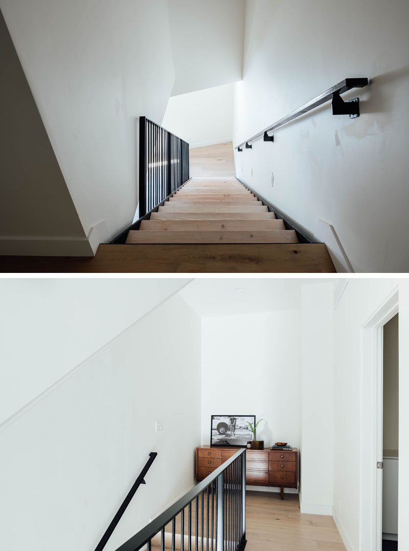 The wood and black steel stairs connect the various levels of this contemporary house, and at the top, there's a small alcove that furnished with a wood sideboard. #Stairs #InteriorDesign