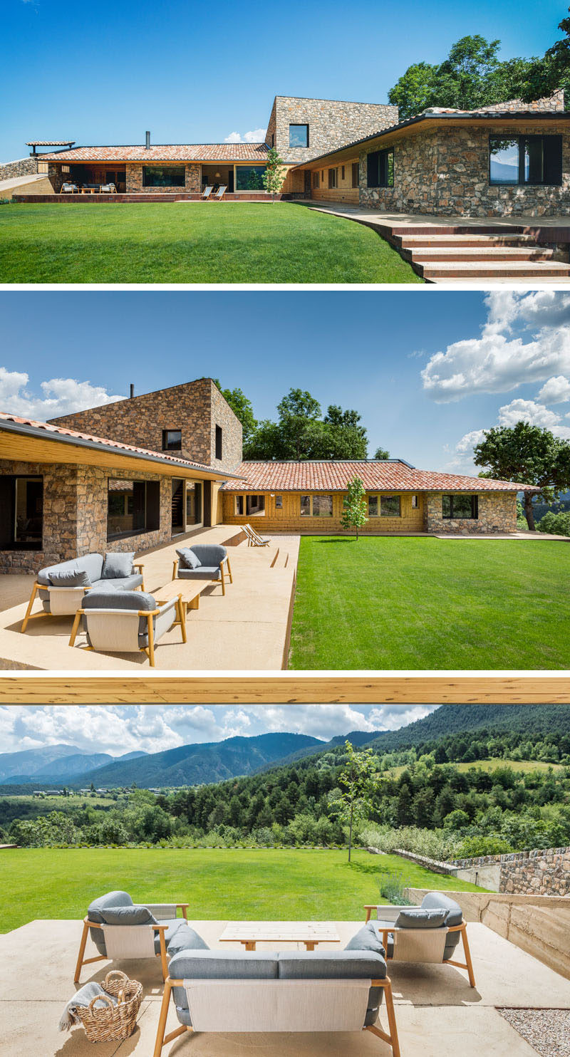 Sliding doors of this contemporary house, open to a porch with multiple levels and large grassy backyard, both of which enjoy views of the valley and the mountain of the Cadí-Moixeró Natural Park.#Landscaping #Porch #ContemporaryHouse #Stone