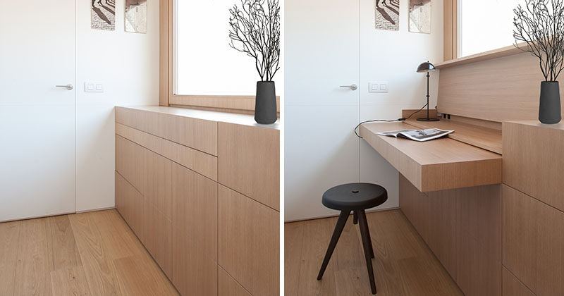 YLAB Arquitectos have hidden a desk in plain sight when they designed a small and modern apartment. The custom-made furniture piece has a hinged top, that when opened, can be used as a desk, and when more space is needed, a section of the cabinetry can be pulled out. #Desk #HiddenDesk #BuiltInDesk #InteriorDesign