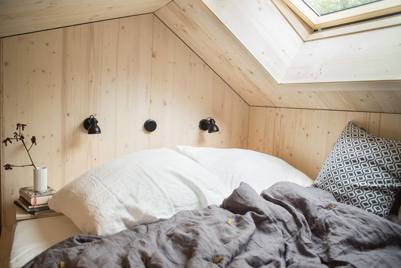 The bedroom in this tiny home has a king size bed that's positioned to look out towards the stars through the skylight. #Bedroom #TinyHome #Skylight