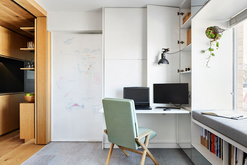 In this small apartment, a sliding door with a whiteboard on one side, can be closed to hide the bedroom from view. #Whiteboard #WhiteboardDoor #HomeOffice