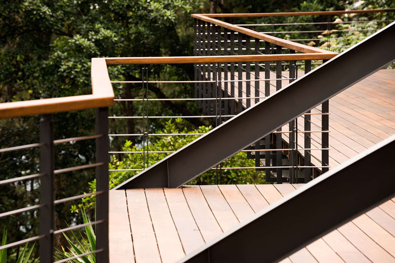 This balcony has a contemporary steel and wood railing. #Balcony #Railing