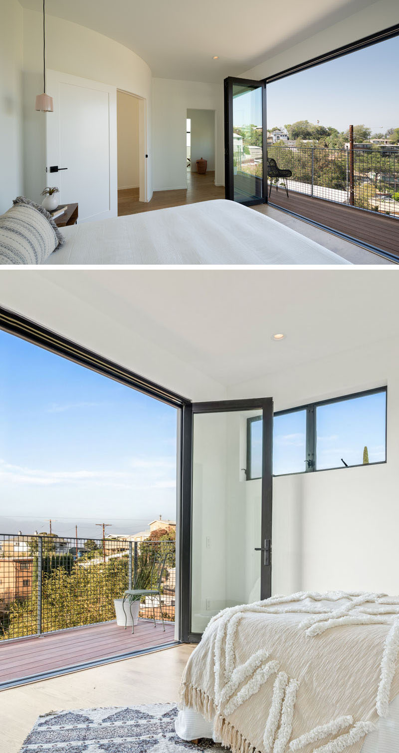 This modern bedroom has folding glass doors that open up to a balcony for picturesque views of the valley. #Bedroom #FoldingGlassDoors #Balcony