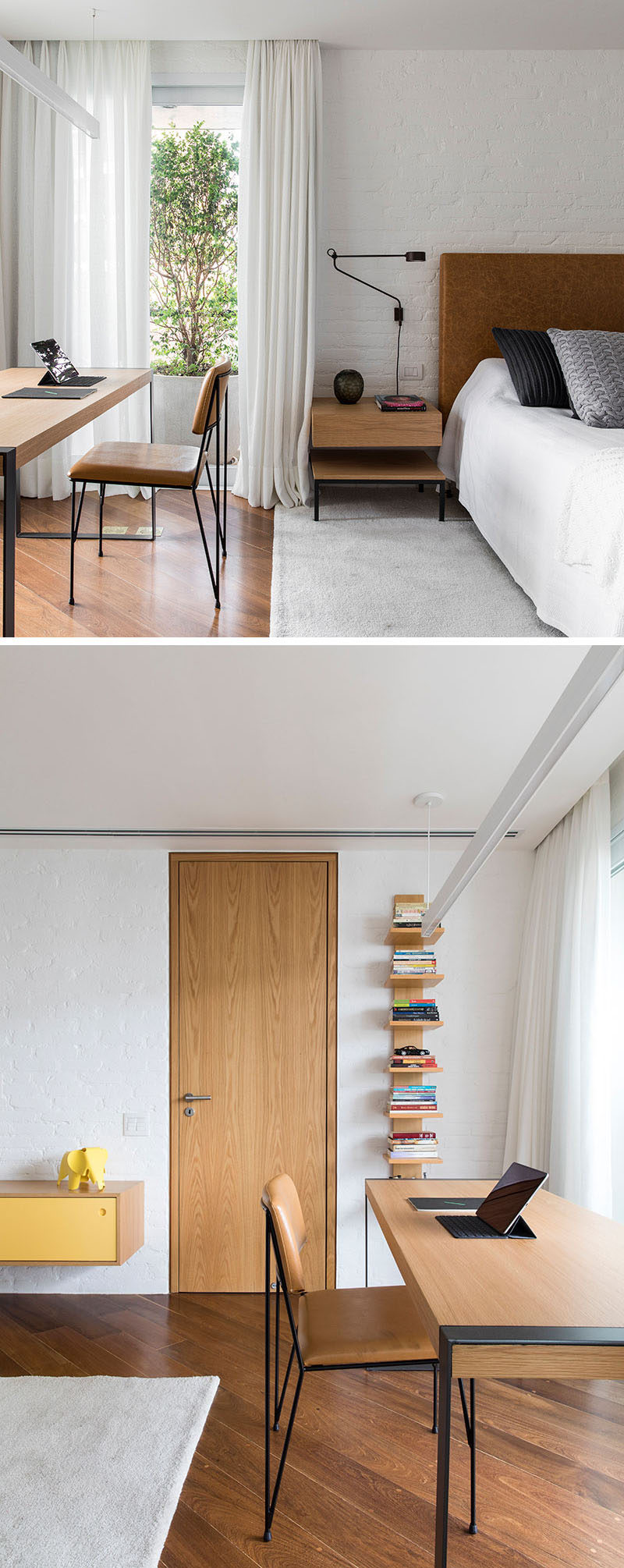 In this bedroom, there's a white painted brick wall, and a study area in front of the windows. An ensuite bathroom is located behind the wood door. #BedroomDesign #ModernBedroom #StudyDesk