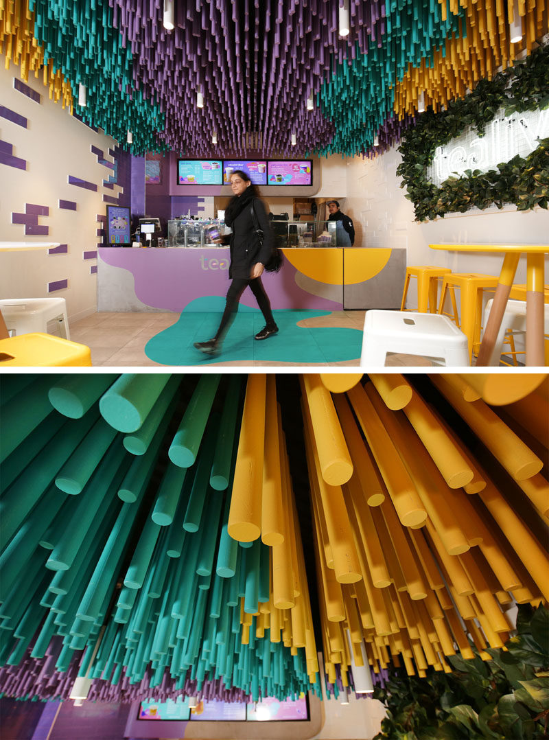 FRETARD Design have completed a bubble tea store that features a colorful dowel accent ceiling and a partial green wall around a neon light. #InteriorDesign #RetailDesign