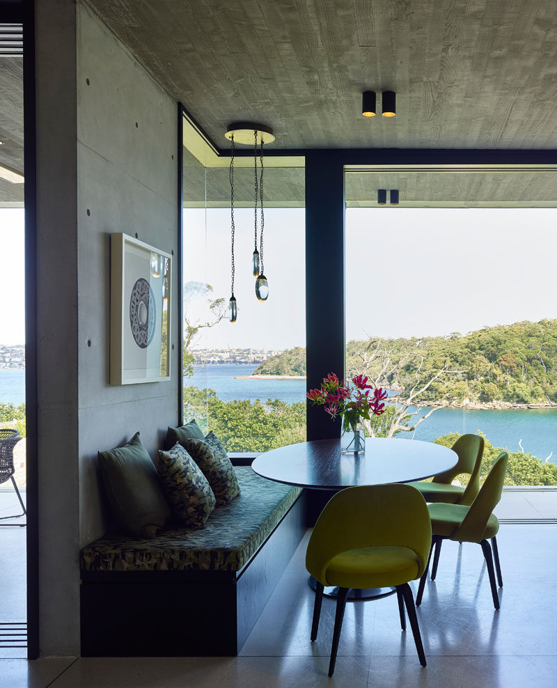 This casual dining area is positioned in front of the windows to take advantage of the water views. #Dining #Windows