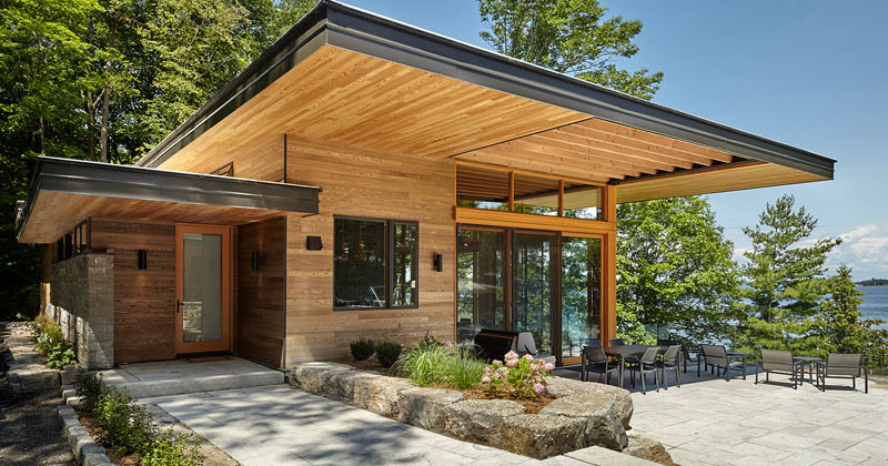 A Couple Of Contemporary Cottages Overlook A Lake In ...